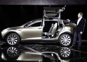 here's why surging demand could be a problem for tesla's new suv